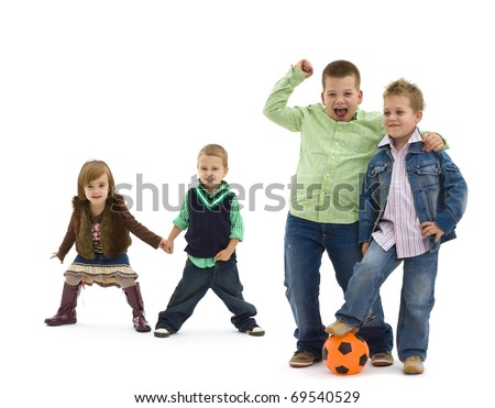 Group of 4 happy children posing together.  laughing and waving. Two boys with football in the forground, two small kids holding hands in the background. Isolated on white. - stock photo