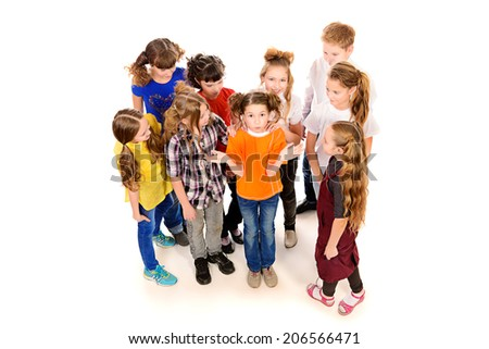 Group of happy children standing together. Isolated over white. - stock photo