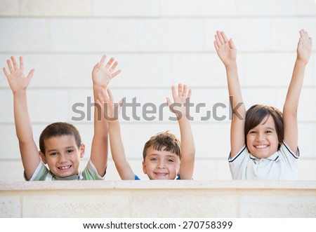 Group of happy children with open arms - stock photo