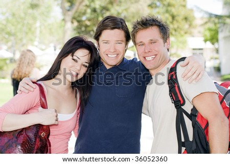 Group of happy college students at a university - stock photo
