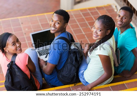 group of happy college students looking back - stock photo