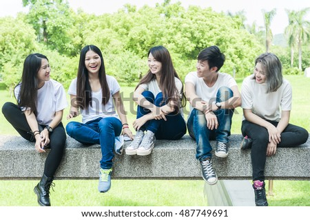 group of happy college students outdoors