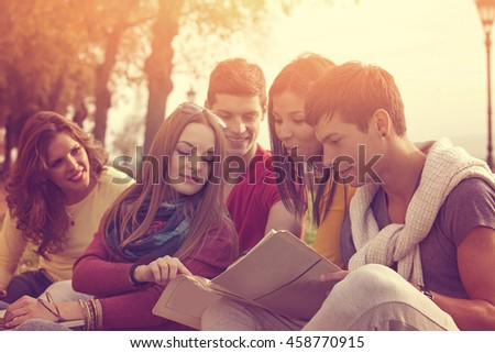Group of happy college students outside - stock photo