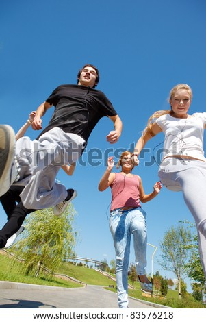 Group of happy college students running - stock photo