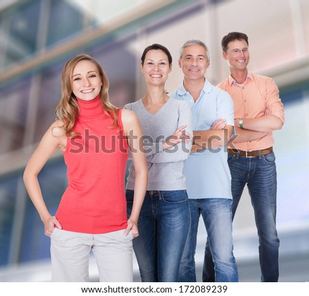 Group Of Happy Confident People Standing In A Row With Arm Crossed - stock photo