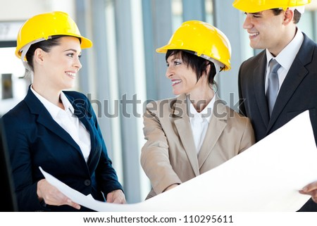 group of happy construction businesspeople interacting - stock photo
