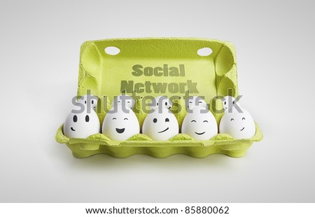 Group of happy eggs with smiling faces representing a social network. Ten white eggs in a carton box. Isolated on a gray background - stock photo