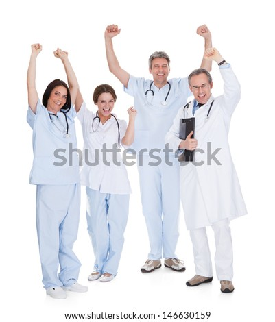 Group Of Happy Excited Doctors With Arm Raised Isolated Over White Background - stock photo