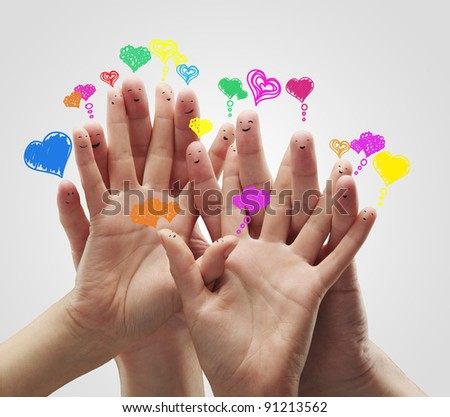 Group of happy finger smileys with love heart speech bubbles and social chat sign. - stock photo