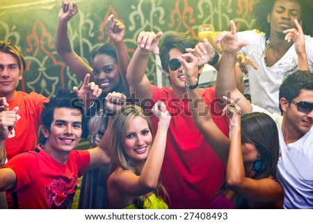 Group of happy friends at a bar or a nightclub