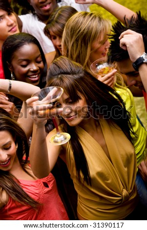 group of happy friends dancing in a nightclub - stock photo