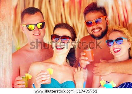 group of happy friends having fun on tropical beach, holiday party - stock photo