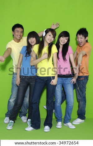 group of happy friends holding grapefruit on their hands - stock photo