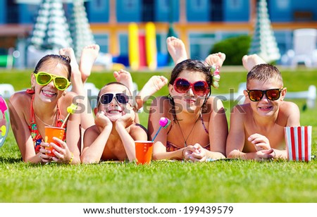 group of happy friends on summer lawn - stock photo
