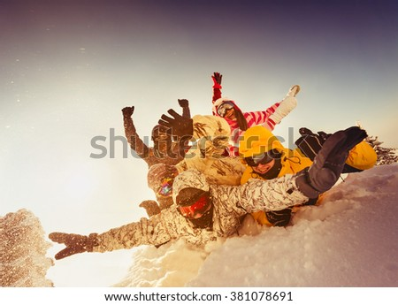 Group of happy friends skiers and snowboarders having fun on the top of a mountain. Sheregesh resort, Siberia, Russia - stock photo