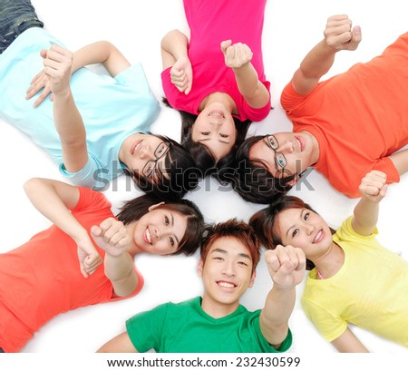 group of happy friends smiling with heads together with hands gesture - stock photo