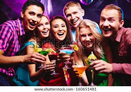 Group of happy friends with cocktails toasting at party - stock photo
