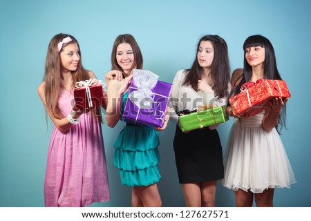 Group of  happy girl with gifts.