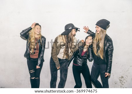 Group of happy girls laughing and having fun outdoors - stock photo