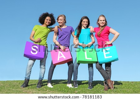 group of happy girls shopping with bags in the sales - stock photo