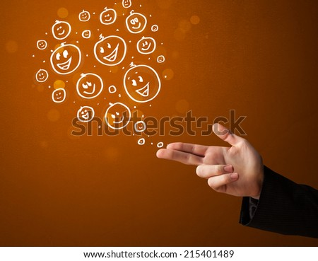 Group of happy hand drawed smiley faces coming out of gun shaped hands - stock photo