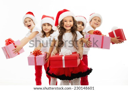Group of happy kids in Christmas hat with presents. Isolated on white background. Holidays, christmas, new year, x-mas concept. - stock photo