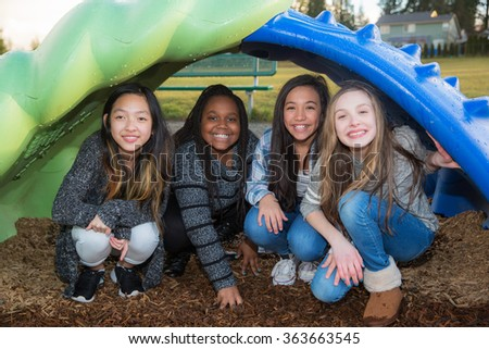 Group of happy kids playing outside - stock photo
