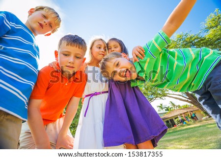 Group of Happy Kids Playing Together Outside, Friendship Concept - stock photo