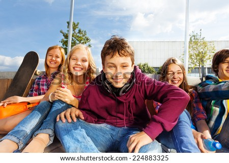 Group of happy kids sitting close to each other - stock photo