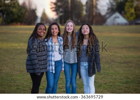 Group of happy kids standing together outside - stock photo