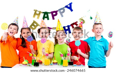 Group of happy kids with colorful candies having fun at the birthday party - isolated on a white. - stock photo