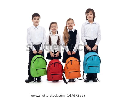Group of happy kids with schoolbags - back to school concept, isolated  - stock photo