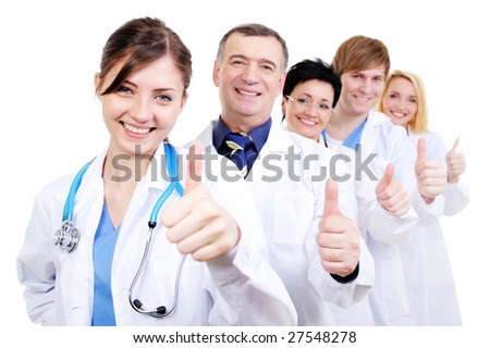 group of happy laughing doctors with gesture thumbs-up standing in line - stock photo