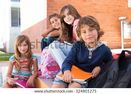 Group of happy little school kids in school