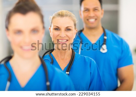 group of happy medical workers line up