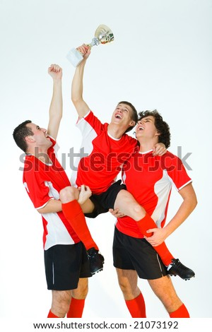 Group of happy men dressed sportswear holding a cup. Front view. - stock photo