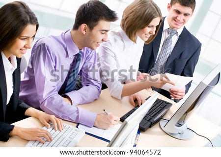 Group of happy multi ethnic business people in a meeting at office