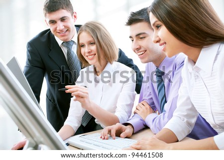 Group of happy multi ethnic business people in a meeting at office - stock photo