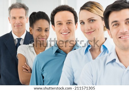Group Of Happy Multi ethnic Businesspeople Looking At Camera - stock photo