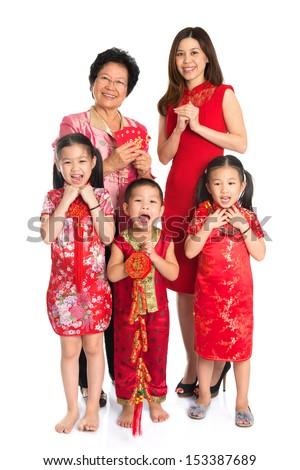 Group of happy  multi generations Asian Chinese family wishing you a happy Chinese New Year, with traditional Cheongsam standing isolated on white background.