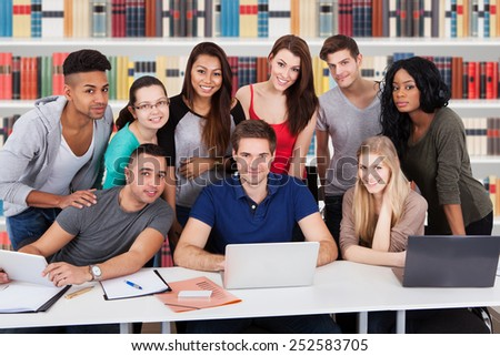 Group Of Happy Multiethnic Friends In Library Studying - stock photo