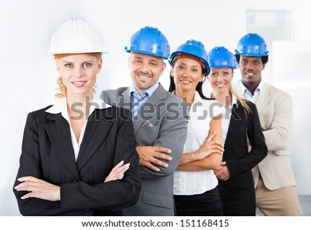 Group Of Happy Multiracial Architects Standing In A Row - stock photo