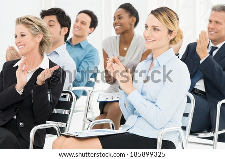 Group Of Happy Multiracial Businesspeople Clapping At Seminar - stock photo