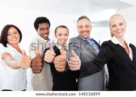 Group Of Happy Multiracial Businesspeople Gesturing Thumb Up Sign - stock photo