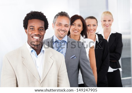 Group Of Happy Multiracial Businesspeople Standing In A Row