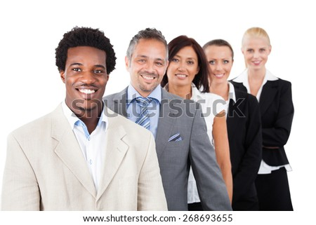 Group Of Happy Multiracial Businesspeople Standing In A Row - stock photo