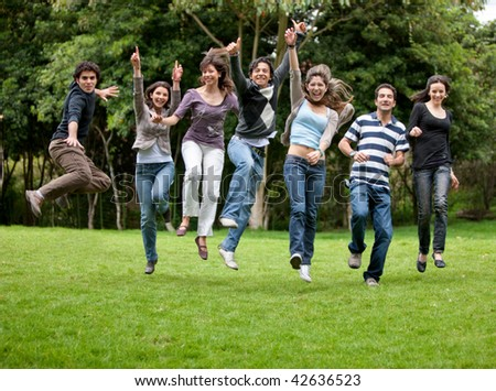 Group of happy people having fun outdoors - stock photo