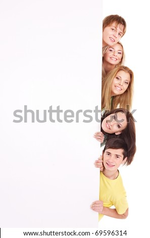 Group of happy people holding banner. Isolated. - stock photo