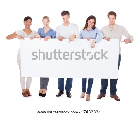 Group Of Happy People Holding White Billboard Over White Background - stock photo