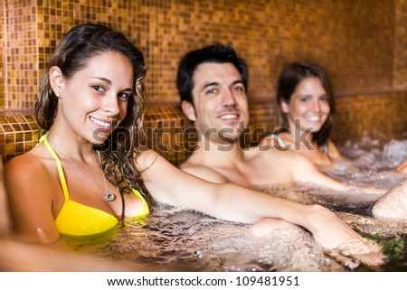 Group of happy people relaxing in a spa - stock photo